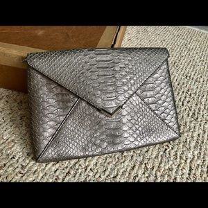 Stella and Dot snake embossed clutch.  Exc. cond